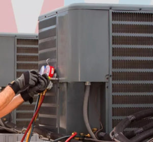air conditioning unit getting repaired